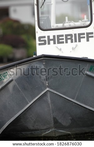 Old metal boat with SHERIFF sign in black letters