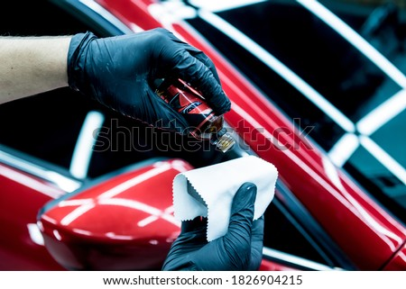 Car service worker applying nano coating on a car detail. Royalty-Free Stock Photo #1826904215