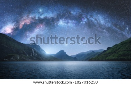 Arched Milky Way over the beautiful mountains and blue sea at night in summer. Colorful landscape with bright starry sky with Milky Way arch, moonlight, constellation, water. Galaxy. Nature and space #1827016250