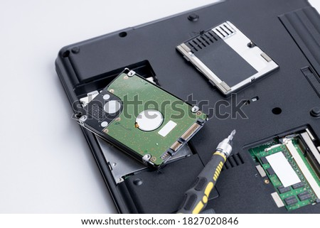 technician worker repairing laptop pc. restore hard disk data store concept. computer hardware repair service conceptual. person checking hdd disk. #1827020846