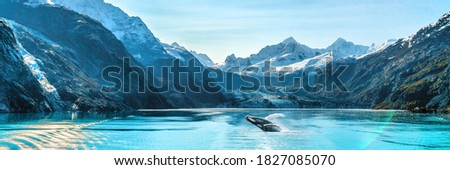 Alaska luxury cruise travel panoramic. Scenery landscape panorama with humpback whale composite breaching out of waters on glacier bay background. Royalty-Free Stock Photo #1827085070