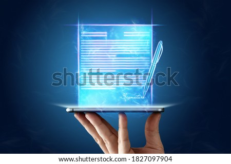 Concept for electronic signature, distance business, mobile phone and contract hologram image for signature. remote collaboration, copy space. Mixed media Royalty-Free Stock Photo #1827097904