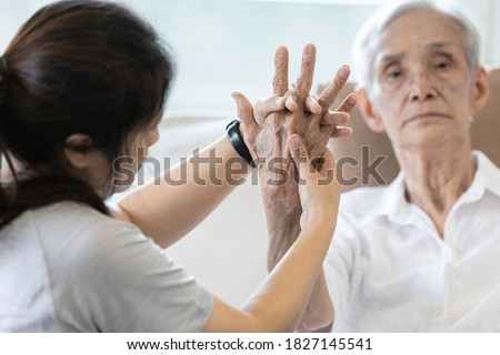 Elderly female patient suffer from numbing pain in hand,arthritis,tendon inflammation,stiffness of the joints,asian senior woman get a palm finger massage to treat beriberi,numbness fingertip concept
