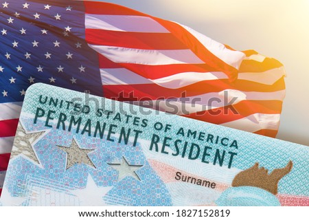 Green Card US Permanent resident card USA. Electronic Diversity Visa Lottery DV-2022 DV Lottery Results. United States of America. American flag on background.  Royalty-Free Stock Photo #1827152819