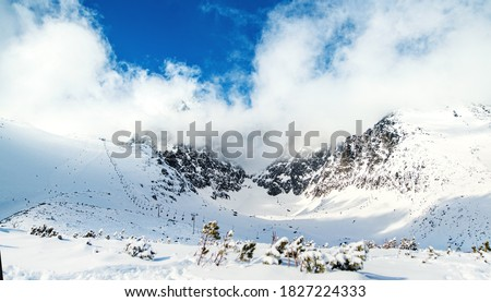 View of snow-covered ski slope in High Tatras in Slovakia. #1827224333