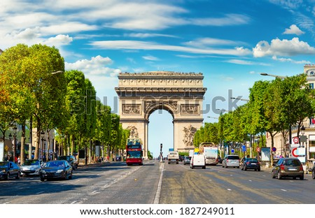 Road of Champs Elysee leading to Arc de Triomphe in Paris, France Royalty-Free Stock Photo #1827249011