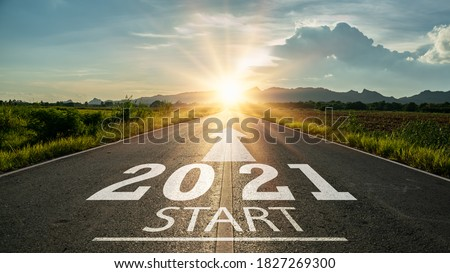 New year 2021 or start straight concept.word 2021 written on the road in the middle of asphalt road at sunset.Concept of planning and challenge or career path,business strategy,opportunity and change Royalty-Free Stock Photo #1827269300