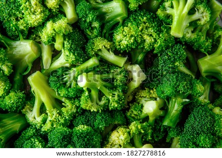 Macro photo green fresh vegetable broccoli. Fresh green broccoli on a black stone table.Broccoli vegetable is full of vitamin.Vegetables for diet and healthy eating.Organic food. #1827278816
