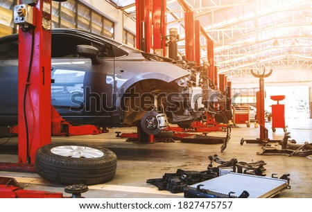 car in automobile repair service center with soft-focus and over light in the background Royalty-Free Stock Photo #1827475757