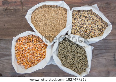 overhead view of bags with animal feed in the forage Royalty-Free Stock Photo #1827499265