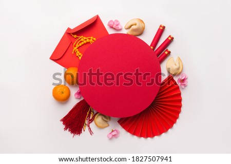 Chinese New Year flat lay white background with assorted festival decorations. Wishing wealth, prosperity and luck, copy space Royalty-Free Stock Photo #1827507941