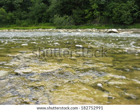 beautiful landscape with speed water in mountainous river #182752991