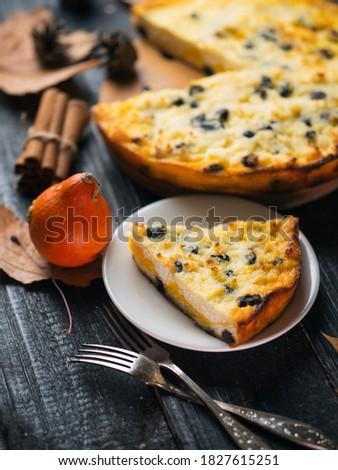 Autumn dessert casserole with pumpkin filling Royalty-Free Stock Photo #1827615251