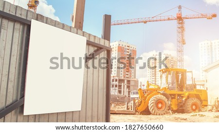 blank information banner with white mockup on metal construction site gate under bright sunlight outside