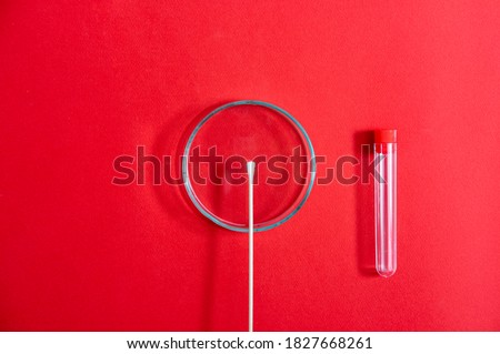 Petri dish with swab on red background stock photo