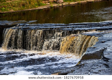 Tosna Falls in Russia. A small waterfall on a long exposure. Beautiful landscape #1827670958