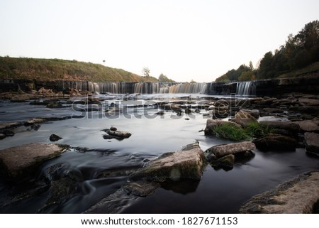 A photo of a small river in Russia, taken on a long exposure. Stone Shore. Beautiful landscape #1827671153