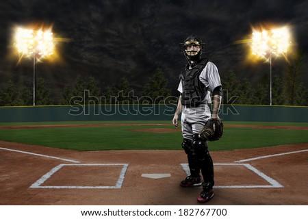 Catcher Baseball Player on a baseball Stadium. Royalty-Free Stock Photo #182767700