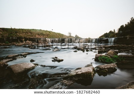 A photo of a small river in Russia, taken on a long exposure. Stone Shore. Beautiful landscape #1827682460