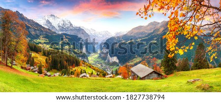 Scenic autumn view of picturesque alpine Wengen village and Lauterbrunnen Valley with Jungfrau Mountain and  on background. Location: Wengen village, Berner Oberland, Switzerland, Europe.