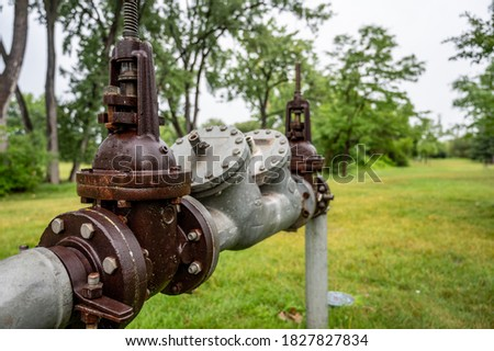 Water main pipe with back flow prevention, double block, and bleed valves Royalty-Free Stock Photo #1827827834