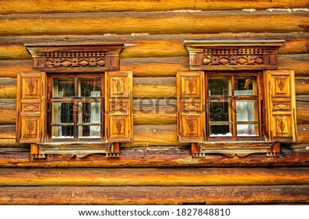 Two vintage wooden windows in russian national style. Malye Korely.  Arkhangelsk, Russia #1827848810