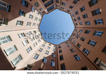 Octagon shape house courtyard. Bottom view octagon building in Saint Petersburg. Beautiful architecture facade style at sunny day