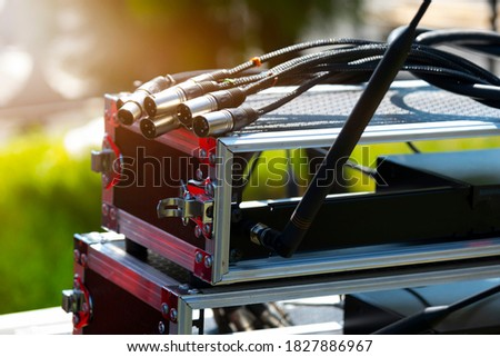 A board with many sockets and connected wires. Sound installation. Sound engineer equipment. Event Concept Royalty-Free Stock Photo #1827886967