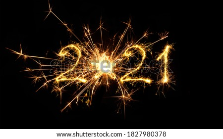 Happy New Year 2021. Creative Number 2021 with sign star written sparkling sparklers isolated on black background. Beautiful Glowing overlay object for design holiday greeting card. #1827980378