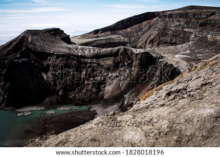 The Gorely Volcano. The crater of the Gorely volcano. Lake in the crater of Gorely volcano. View of the Vilyuchinsky volcano. Kamchatka. July 2020.
