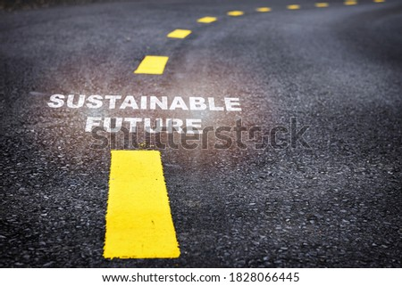 Sustainable future word on asphalt road surface with marking lines. Inspiration and motivation concept and effort idea Royalty-Free Stock Photo #1828066445