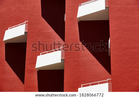 Geometric red building facade. Architectural symmetrical design. Urban perspective