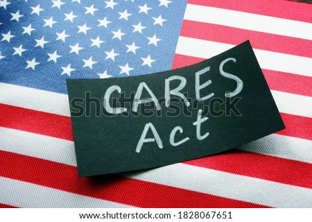 USA flag and word CARES act The Coronavirus Aid, Relief, and Economic Security Act. Royalty-Free Stock Photo #1828067651