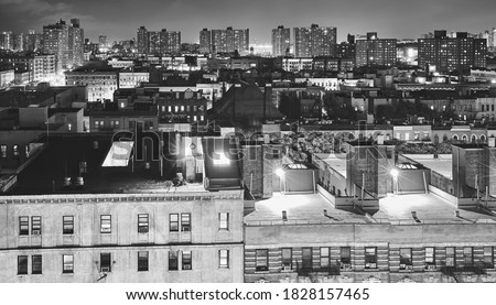 Black and white picture of Harlem neighborhood at night, New York City, USA.