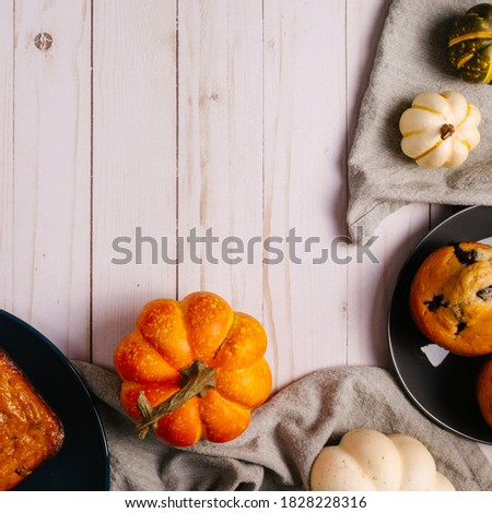 Square image of the harvest season. Pumpkins on the wooden background. Cozy fall backdrop. Trendy fall picture. Thanksgiving vibes.