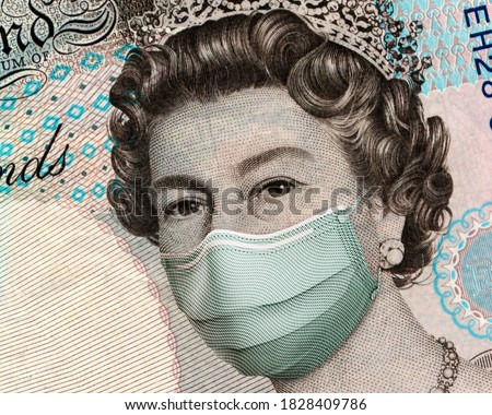 COVID-19 in UK, Close up of 5 British Pounds banknotes, with Queen Elisabeth II wearing healthcare surgical mask. Impact of the coronavirus pandemic on the UK economy. devaluation of the UK currency. Royalty-Free Stock Photo #1828409786