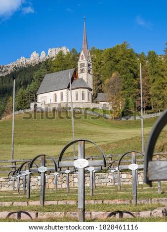 Church San Giuliana, in the foreground an Austrian war cemetery from WW 1. Vigo di Fassa (Vich) in valley Val di Fassa in the Dolomites. Italy. #1828461116