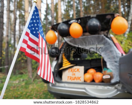 Trick or trunk. Concept celebrating Halloween in trunk of car. New trend celebrating traditional October holiday outdoor. Social distance and safe alternative celebration during coronavirus covid-19 Royalty-Free Stock Photo #1828534862