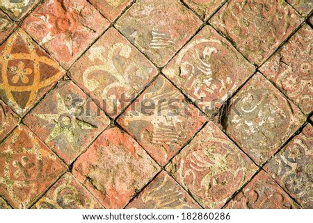 Ancient decorative quarry tile floor, depicting birds, flowers and stars. #182860286