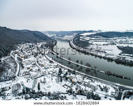 Seasons Concept winter Aerial view of the mosel village Brodenbach in Germany on a misty day Royalty-Free Stock Photo #1828602884