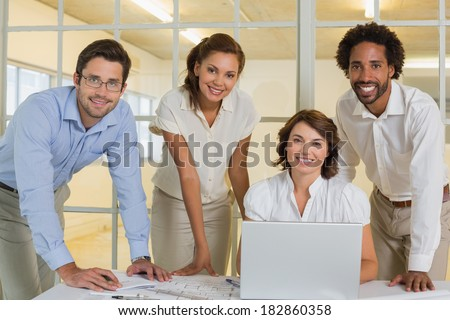 Portrait of happy business people using laptop in meeting at the office #182860358