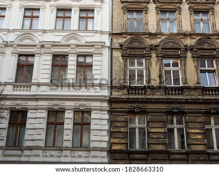 Refurbished and not renovated old building in contrast next to each other in Berlin, Germany Royalty-Free Stock Photo #1828663310