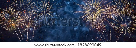 Panoramic Beautiful Holiday background Happy of fireworks. Concept of happiness and joy. Wide Angle blue billboard or Web banner With Copy Space for design. Universal Wallpaper for celebration Royalty-Free Stock Photo #1828690049