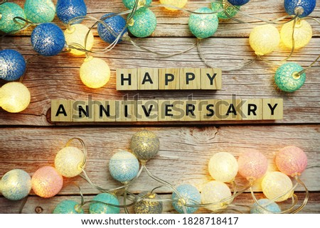Happy Anniversary alphabet letter with LED cotton balls decoration on wooden background Royalty-Free Stock Photo #1828718417