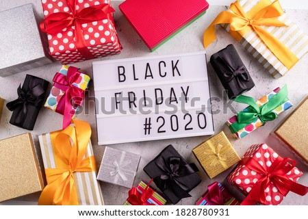 Black friday Sale 2020 text words on lightbox with various gift boxes
