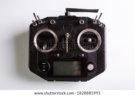 Black remote control for drone. Top view on white background. Horizontal orientation.