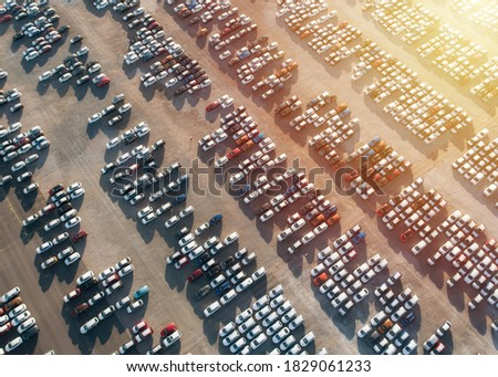 Aerial view new cars parking for sale stock lot row, New cars dealer inventory import export business commercial global, Automobile and automotive industry distribution logistic transport worldwide. Royalty-Free Stock Photo #1829061233