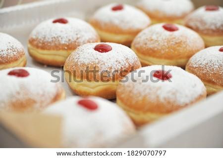 Hanukkah symbol jewish food holiday image of donut with jelly and sugar powder.