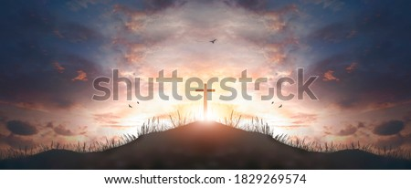 cross religion symbol silhouette in grass over sunset  sky cross religion symbol silhouette in grass over sunset or sunrise sky  Royalty-Free Stock Photo #1829269574