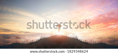 Holy concept: Silhouette cross on  mountain sunset background Royalty-Free Stock Photo #1829348624
